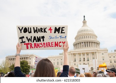 WASHINGTON MARCH 15: A protester holds a sign at Tax March, where participants called on President Trump to release his tax returns.  The march was held in Washington DC on tax day, April 15, 2017.