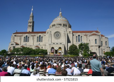 WASHINGTON - MAY 15: Crowd observes during graduation ceremonies at the Catholic University of America (CUA), beside the Basilica of the Shrine of the Immaculate Conception on May 15, 2010 in Washington DC
