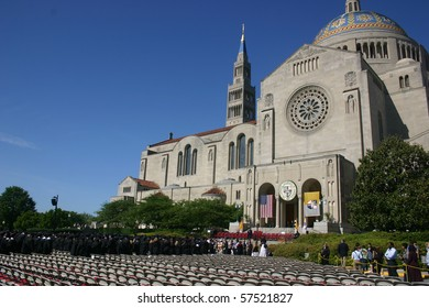 WASHINGTON - MAY 15: Graduates file to their seats as graduation ceremonies begin at the Catholic University of America (CUA), beside the Basilica of the Shrine of the Immaculate Conception on May 15, 2010 in Washington DC