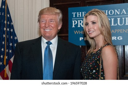 WASHINGTON - MAY 27, 2014 - Real estate mogul Donald Trump and his daughter Ivanka pose before his luncheon speech to the National Press Club.