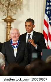 WASHINGTON - MAY 29: Former U.S. Supreme Court Justice John Paul Stevens receives the Presidential Medal of Freedom at a ceremony at the White House May 29, 2012 in Washington, D.C.