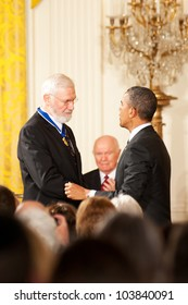 WASHINGTON - MAY 29: President Barack Obama congratulates William Foege after receiving the Presidential Medal of Freedom award at a ceremony at the White House May 29, 2012 in Washington, D.C.