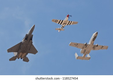 WASHINGTON - MAY 8:f-15, p-51, a-10 Performing Heritage Flight to honor US Air Force veterans from the past wars on May 8, 2012 in Washington. All 3 planes are representing different era of aviation