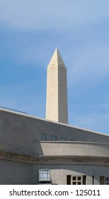 The Washington Monument in Washington, DC over the roof of the Holocaust Museum.