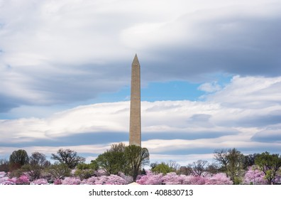 Washington Monument in Washington DC USA with the American flag waving in front