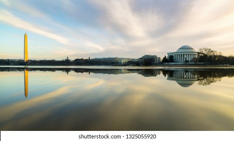 The Washington Monument And Jefferson Memorial at Sunrise