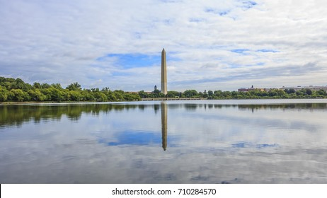 The Washington Monument, long distance, reflecting in water