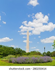 Washington Monument on Memorial Day weekend. Washington Monument against a cloudy blue sky.