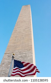 Washington monument, view from base with flag in foreground.