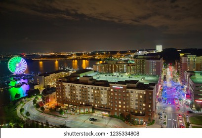 Washington National Harbor, Maryland, USA - August 18, 2018: Night in National Harbor at Potomac river with illuminated Ferris wheel