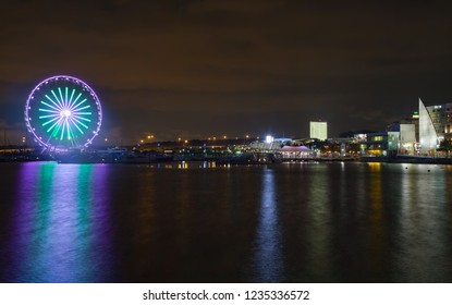 Washington National Harbor, Maryland, USA - August 19, 2018:Potomac River at night with Ferris wheel in National Harbor, Maryland