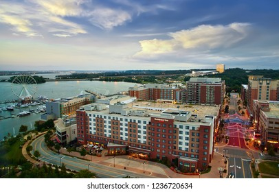 Washington National Harbor, Maryland, USA - August 18, 2018: Morning in National Harbor at Potomac river with  Ferris wheel and illuminated streets