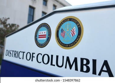 WASHINGTON - NOVEMBER 2, 2019: DISTRICT OF COLUMBIA COURTS - APPEALS and SUPERIOR COURT sign at building exterior with coat of arm seal emblem