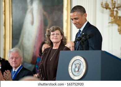Washington � November 20: Dr. Linnea Smith accepts the Presidential Medal of Freedom for husband Dean Smith at The White House on November 20, 2013 in Washington, DC.  Mr. Smith was ill.