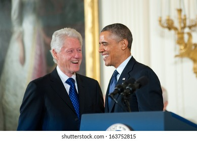 Washington - November 20: Former President Bill Clinton and President Barack Obama share a laugh before Clinton receives the Presidential Medal of Freedom on November 20, 2013 in Washington, DC.