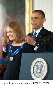 Washington � November 20: Gloria Steinem receives the Presidential Medal of Freedom from President Obama at a ceremony at The White House on November 20, 2013 in Washington, DC.