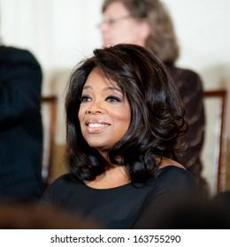 WASHINGTON - NOVEMBER 20: Oprah Winfrey listens to President Barack Obama at the Presidential Medal of Freedom ceremony at the White House November 20, 2013 in Washington, D.C.