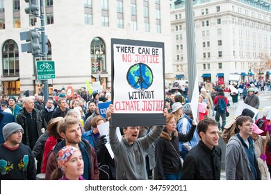 WASHINGTON - NOVEMBER 29: Marchers take part in the Global Climate March in Washington, DC on November 29, 2015, the eve of the United Nations Climate Change Conference in Paris.