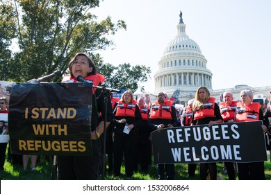 WASHINGTON - October 15 2019: Margaret Huang, Executive Director of Amnesty International USA, speaks to protesters at the Refugees Welcome protest outside the Capitol. She was later arrested.