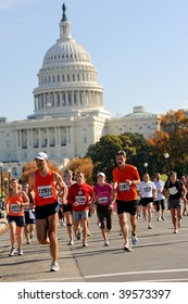 WASHINGTON- OCTOBER 25: Runners compete in the Marine Corps Marathon on October 25, 2009 in Washington, D.C.