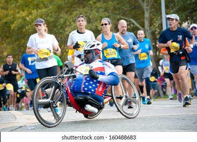WASHINGTON - OCTOBER 27: A hand cyclist competes in the Marine Corps Marathon on October 27, 2013 in Washington, DC