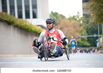 WASHINGTON - OCTOBER 27: A hand cyclist runner competes in the Marine Corps Marathon on October 27, 2013 in Washington, DC