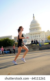 WASHINGTON- OCTOBER 31: A runner passes the Capitol during the Marine Corps Marathon on October 31, 2010 in Washington, D.C.