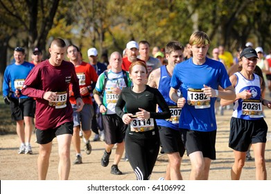 WASHINGTON- OCTOBER 31: Runners compete in the Marine Corps Marathon on October 31, 2010 in Washington, D.C.