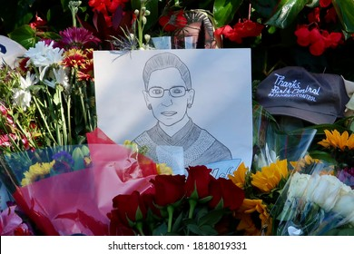 WASHINGTON - SEPTEMBER 19, 2020: Flowers and gifts left in memoriam at US SUPREME COURT honoring JUSTICE RUTH BADER GINSBURG