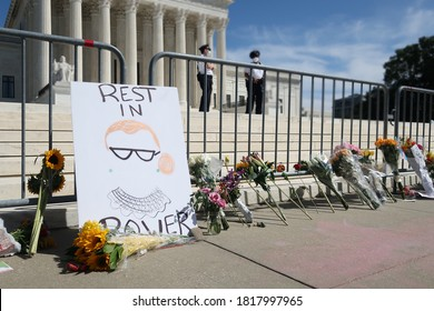 WASHINGTON - SEPTEMBER 19, 2020: Sign and flowers placed at US SUPREME COURT to mourn the death of JUSTICE RUTH BADER GINSBURG