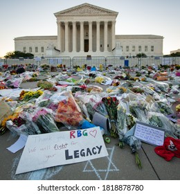 WASHINGTON SEPTEMBER 20, 2020 – Notes and flowers are left at the Supreme Court of the United States in memory of the late Supreme Court Justice Ruth Bader Ginsburg in Washington DC on September 20, 2
