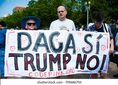 WASHINGTON SEPTEMBER 5: A DACA supporter holds a sign at a rally  in Washington DC on September 5, 2017, the day on which President Trump announced that he would end the DACA program