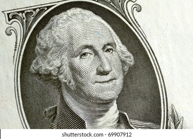 Washington smiling on a 1 dollar bill