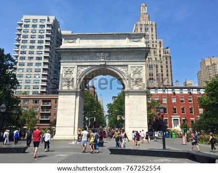 Washington Square Arch, New York, U.S. - 26 June 2016: One of the famous landmarks, people were walking through.