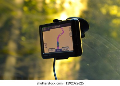 WASHINGTON STATE, USA - CIRCA DECEMBER 2013: A Garmin Nuvi GPS navigation is attached to the windshield of a car.