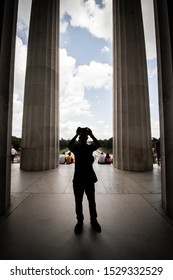 Washington, United States - August 21, 2019: Tourist taking photos at the Lincoln Memorial