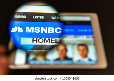 Washington, USA - April 09, 2019: MSNBC News website homepage on the tablet screen. MSNBC News channel logo visible  through a magnifying glass. Can be used as marketing or business concept