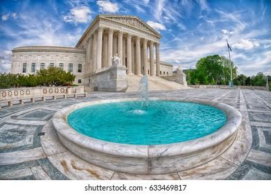 WASHINGTON, USA - APRIL, 29 2017 Washington DC Supreme Court facade equal justice under the law on sunny day