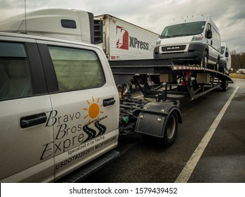 Washington, PÁ / USA Dec 4, 2019 Hotshot car hauling truck in One of many rest areas along I-79. This three cars hauler was transporting two Dodge RAM Cargo Van.