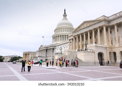 WASHINGTON, USA - JUNE 13, 2013: People visit the US Capitol in Washington DC. 18.9 million tourists visited capital of the United States in 2012.