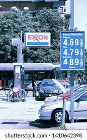 WASHINGTON, USA - JUNE 14, 2013: People visit Exxon gas station in Washington, DC, USA. ExxonMobil is the 3rd largest company in the world by revenue (420 billion USD in 2013).
