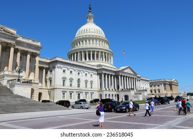 WASHINGTON, USA - JUNE 14, 2013: People visit the US Capitol in Washington DC. 18.9 million tourists visited capital of the United States in 2012.