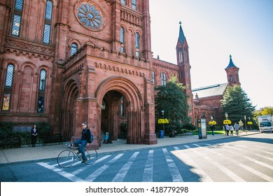 Washington, USA - October 19, 2015: Entrance to Smithsonian Castle in Washington DC. Streets, Architecture and traffic of Washington DC. Washington is the capital of the United States