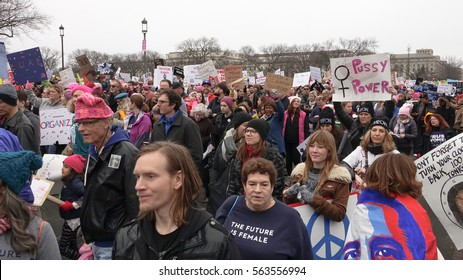 WASHINGTON,DC - JAN 21, 2017: Women's March on Washington, crowd passes with banners, part of gigantic turnout that flooded DC in an anti-inauguration show of solidarity.