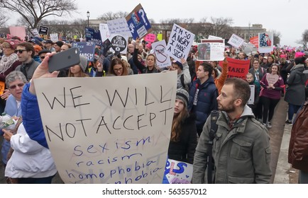 WASHINGTON,DC - JAN 21, 2017: Women's March on Washington, marchers pass with signs, part of gigantic turnout that flooded DC in an anti-inauguration show of solidarity.