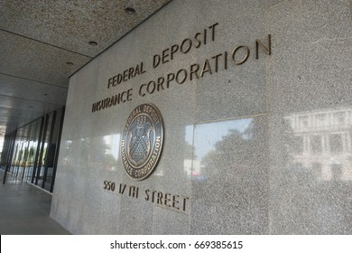 WASHINGTON,DC - JUNE 14, 2017: Sign & seal of Federal Deposit Insurance Corporation headquarters, across from Executive Office Building (reflecting). FDIC is an independent agency created by Congress