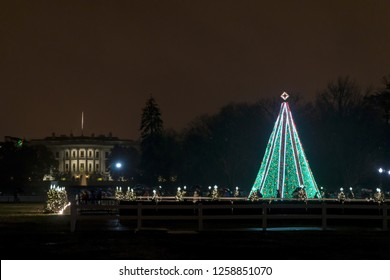 Washington,DC / USA - December 15, 2018: the National Christmas Tree is lit up behind the White House.