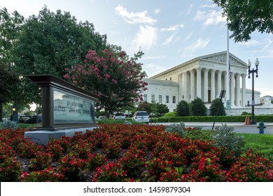 Washington,DC / USA - July 24, 2019: flags fly at half-staff as the US Supreme Court mourns the loss of the late Justice John Paul Stevens.