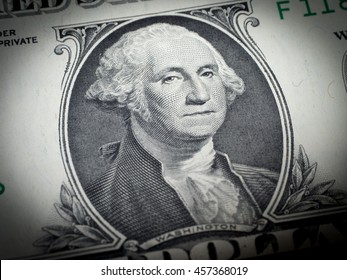 Washington's face on a dollar bill (Focus on face)