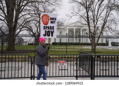 Washington/USA – January 19, 2019: Demonstrator at the White House with an anti-Trump poster during the 2019 Women's March.
